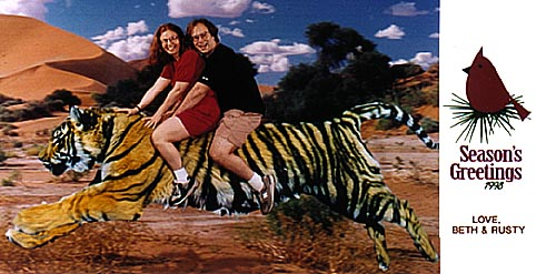 Beth and Rusty riding a tiger, Seasons' Greetings!